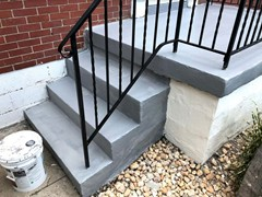 After pressure washing and repairing the side of these steps, a new finish coating drastically changed their look.