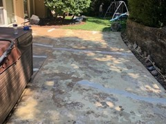 Though they do not show up well in the before photo, the second photo shows where cracks have been repaired on the back patio. Bronze colored Saf-T-Deck elastomeric coating was used to finish this restoration