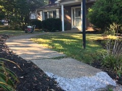 The end of this sidewalk needed to be rebuilt. We started by power washing to clear the surface. The we rebuilt the front and back corner with polymer cement before resurfacing the entire pad so that repairs are hidden and it has a fresh look.