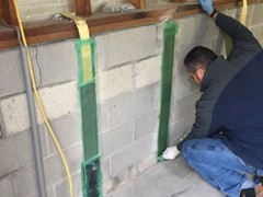 The owner of A Plus Concrete and Foundation Repair, Gary, works on every stabilization project we complete. Here he is applying the epoxy glue to the Carbon-Fiber and Kevlar strap.