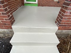 The porch had cracks and pieces missing from the steps. Our team repaired all cracks and rebuilt steps where needed using polymer cement. The finish look is a resurfacer on the entire porch and steps